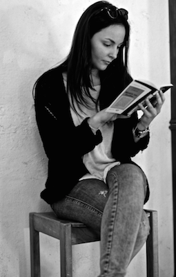 Image of a woman reading a book