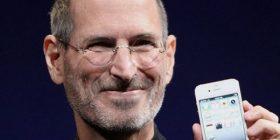 Steve Jobs holding an iPhone